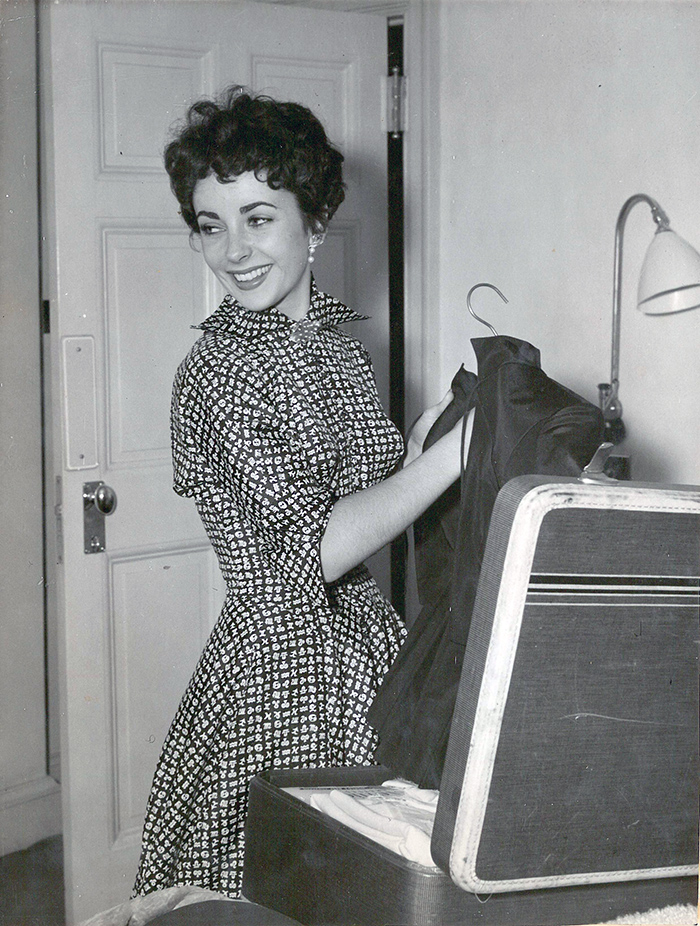 Elizabeth Taylor unpacks in her suite at the Savoy, 1950s