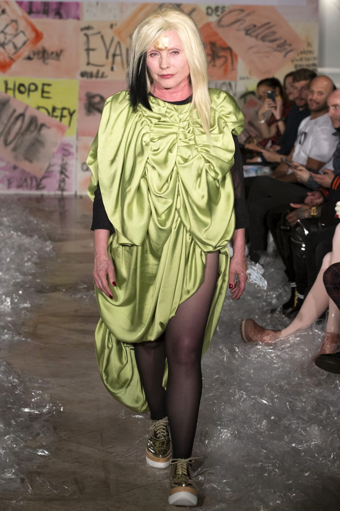 VIN+OMI Debbie Harry wearing Stop F-ing the Planet collection