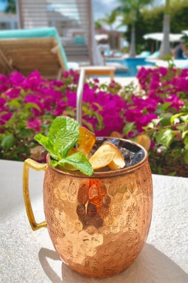 Grace Bay Beach, where Wymara Resort & Villas' rosé-themed beach bar, Pink Bar, puts a twist on the classic cocktail with spiced rum. It's called the Caribbean Mule