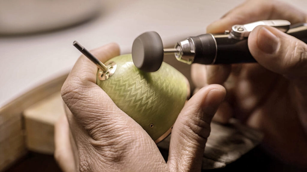 Fabergé Hand polishing the enamel on the egg object. Credit A layer of enamel is hand painted. Credit Fabergé