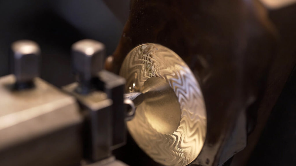 The guilloché engraved gold disk is created with the engine turning machine. Credit Fabergé